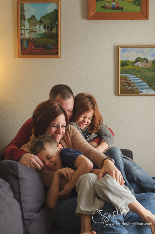 A family cuddles together in a tight group hug, by maryland family photographer jen snyder