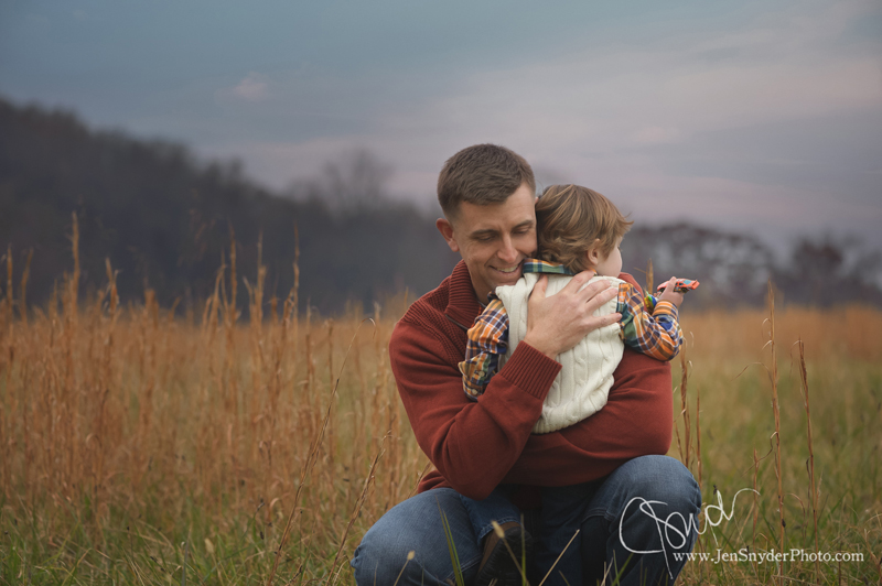A father gives his little boy a big hug in a family portrait by harford county family photographer jen snyder