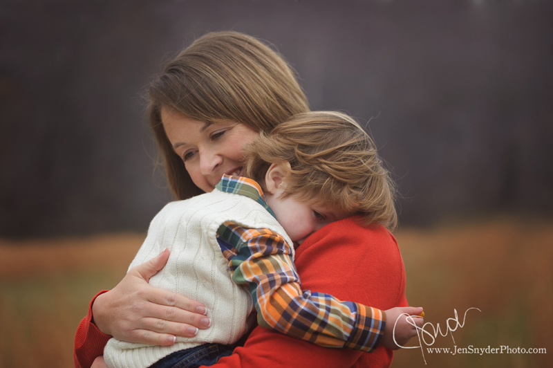 a mother from Joppa, MD comforts her toddler son in an emotional portrait by maryland family photographer jen snyder