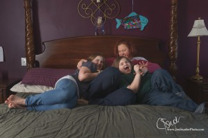 mom tickles kids on the bed, by harford county family photographer jen snyder