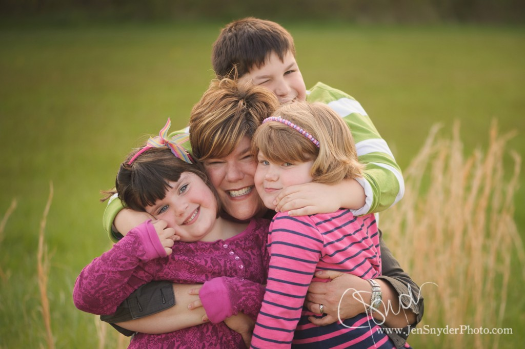 a mother hugs her three kids by maryland family photographer jen snyder