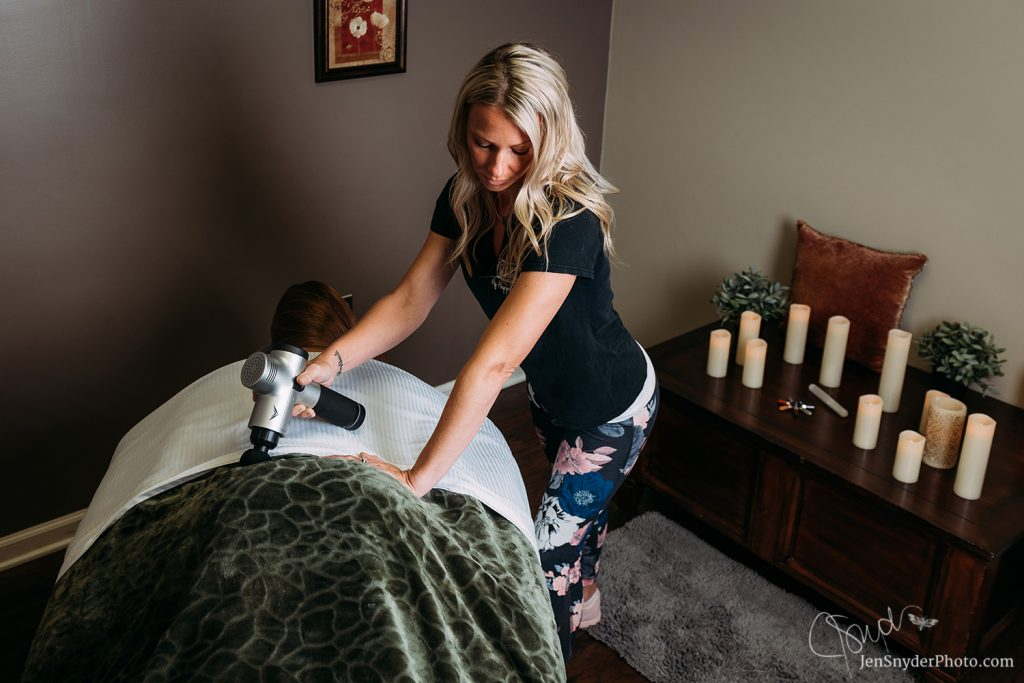 hypervolt therapy at my happy place massage studio, by Harford County branding and marketing photographer Jen Snyder https://www.jensnyderphoto.com