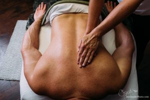 hands massaging a back, by Harford County branding and marketing photographer Jen Snyder https://www.jensnyderphoto.com