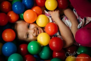 little girl in ball pit, by harford county family photographer jen snyder https://www.jensnyderphoto.com