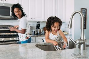 little girl doing the dishes, by Harford County family photographer Jen Snyder https://www.jensnyderphoto.com
