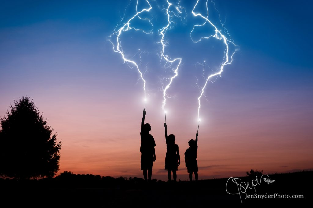 3 kids hold up magic wands to cast a spell